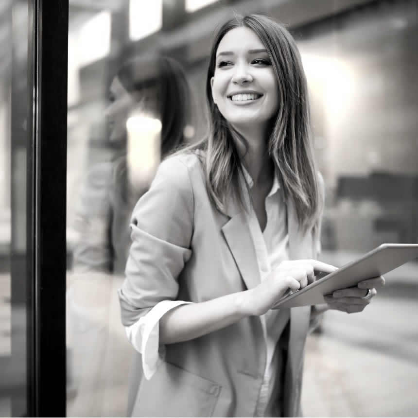 Urban happy business woman using tablet for learning and development purposes